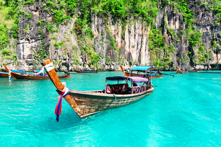 Famous Maya Bay lagoon at Ko Phi Phi Leh Island with thai traditional longtail boat, surrounded by limestone cliffs in Krabi Province, Andaman Sea. Thailand