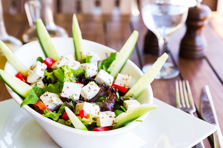 Greek Mediterranean salad with feta cheese, tomatoes and peppers. Mediterranean salad. Greek cuisine.