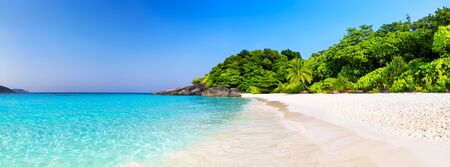 Beautiful beach and blue sky in Similan islands, Thailand. Vacation holidays background wallpaper. View of nice tropical beach. Panorama of travel summer holiday background concept.