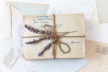 Vintage background with old letters, paper and photos. Retro letters and envelopes. 스톡 콘텐츠
