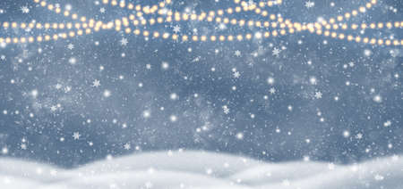 Decorative Christmas background with bokeh lights and snowflakes. Christmas and Happy New Year blue background with snowflake. Winter landscape with falling snow.