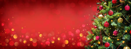 Christmas and New Year holiday background with copy space for your text. Winter christmas decoration with fir tree, garland lights, holiday festive background.