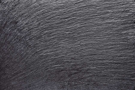 Dark gray black slate background or texture. Empty black stone background. Top view. Free copy space. 스톡 콘텐츠