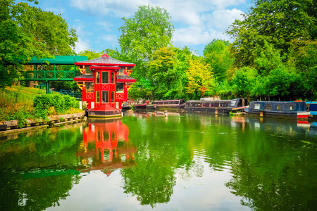 Traditional narrowboats and houseboats moored on the Regents Canal at Little Venice in west London. Stock Photo