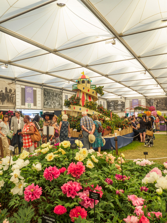 keywords: LONDON, UK - MAY 25, 2017: RHS Chelsea Flower Show 2017. Visitors observing displays in the Grand Pavillion. Editorial