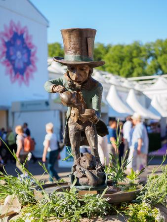 LONDON, UK - MAY 25, 2017: RHS Chelsea Flower Show 2017. Lewis Carrolls Alice in Wonderland characters as sculptured garden figures.