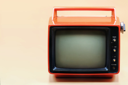 Red retro television on peach color background, With place for text