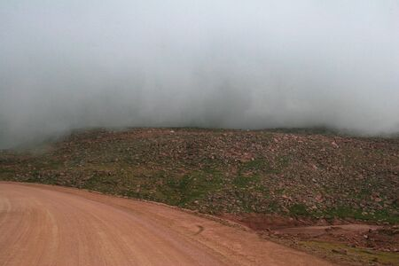 Mountain road with fog on an summer or spring day