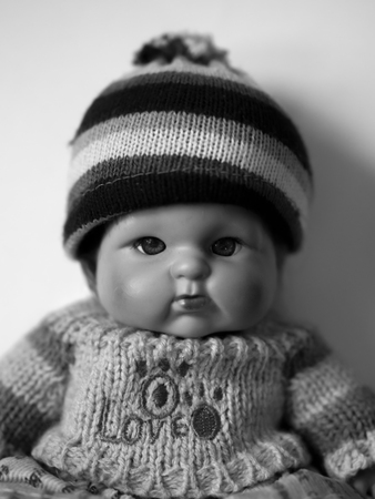 BLACK AND WHITE PHOTO OF DOLL PORTRAIT Stock Photo