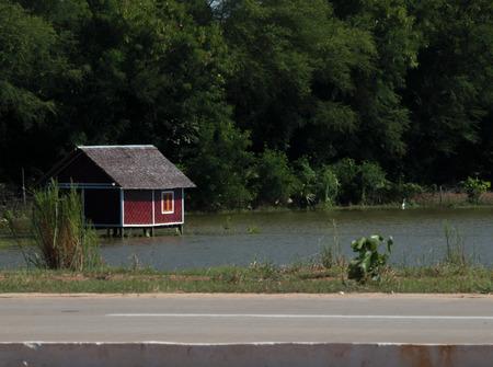 built in: HUT BUILT IN WATER BY HIGHWAY