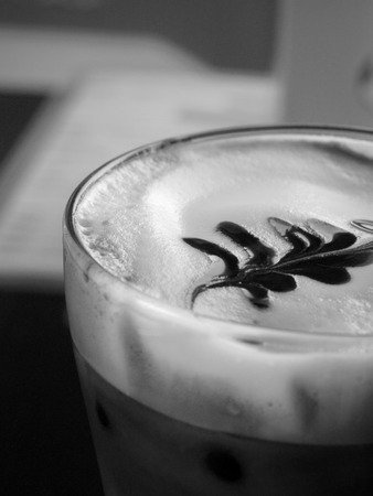 skim: BLACK AND WHITE PHOTO OF ICED CAPPUCCINO WITH LATTE ART