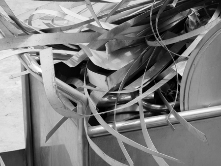 BLACK AND WHITE PHOTO OF SCRAP HEAP OF SILICON STEELS AND RUSTIC METALS