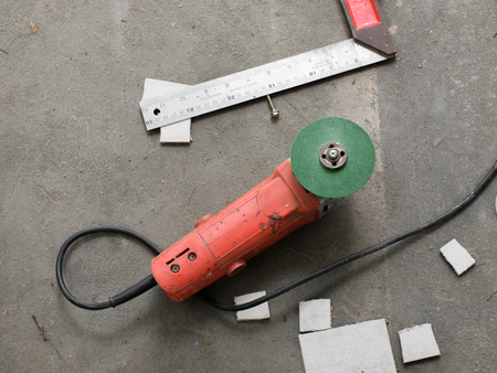 rounded circular: PLUGGED ELECTRIC GREEN WHEEL GRINDER Stock Photo