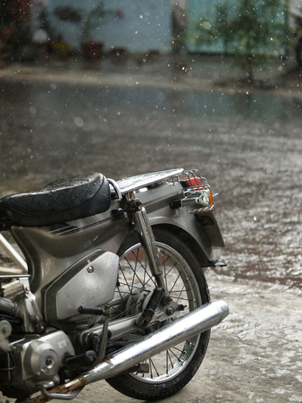 COLOR PHOTO OF MOTORCYCLE AND CLOSE-UP OF RAINDROPS