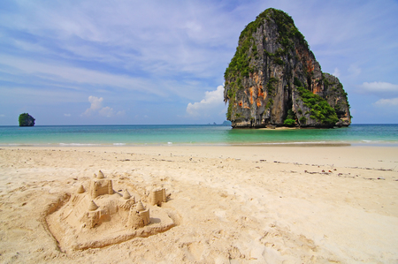phra nang: This is Ao Tham Phra Nang Beach.It a perfect beach that attracts thousands of visitors year round but is able to maintain its flawless appearance and relaxing ambience. Although these attractions are accessible only by boat, they still draw numerous visit Stock Photo