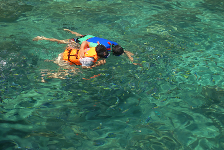 skin diving: Snorkelling or Skin Diving is the practice of swimming on or through a body of water while equipped with a diving mask, a shaped tube called a snorkel, and usually swim fins. it appeals to all ages because of how little effort there is, and without the ex