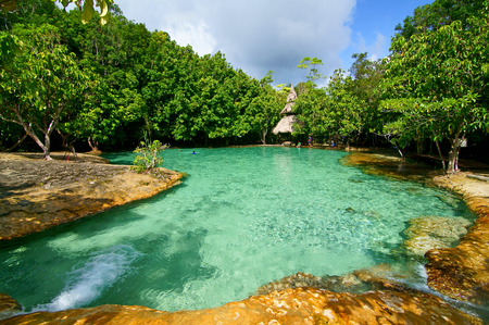This is Emerald Pool. This hot spring originates from a warm stream in the lowland forest of Khao Nor Juji which is supposedly Thailand photo