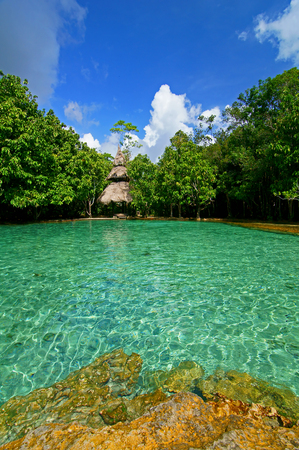 This is Emerald Pool. This hot spring originates from a warm stream in the lowland forest of Khao Nor Juji which is supposedly Thailand