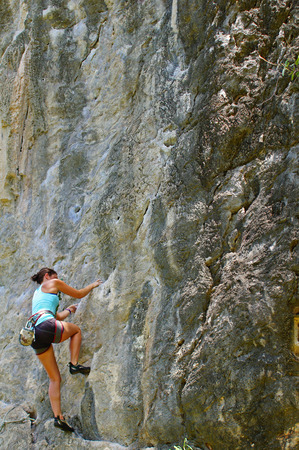 This is cliffs on the huge headland between Hat Rai La East and Tham Phra Nang, as well as other nearby islands provide world-class rock climbing facilities against a stunning backdrop of the sea with approximately 700 sport routes of mid to high difficul photo