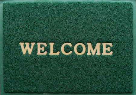 clean carpet: background of green welcome carpet
