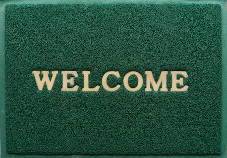 the welcome: fondo de la alfombra de bienvenida verde