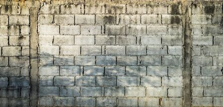 hollow walls: grey cement bricks house wall Stock Photo