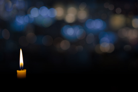candle flame with abstract bokeh background Stock Photo