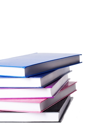 stack og colorful books on a white studio background photo