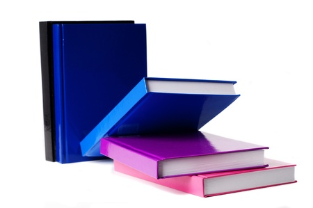 five colorful books on a white cutout background photo