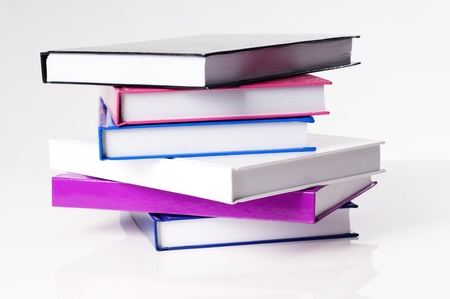 six books on a white table for cutout photo