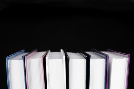books from the side on a black background for cutout photo