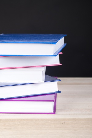pile of five books for reading with a blackbackground photo