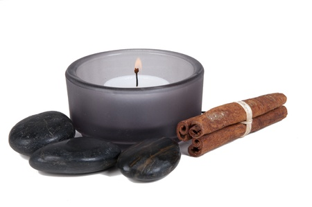 Sa candle with hotstones isolated on white background photo