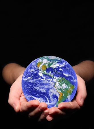 earth in woman hands on black background photo