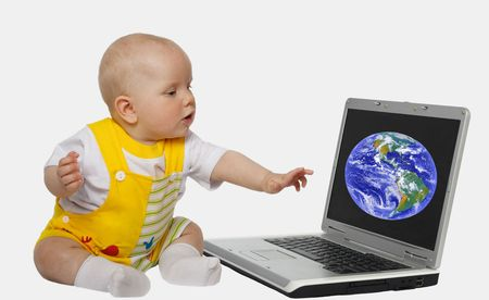 little girl touching screen on the laptop photo