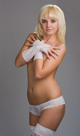 Beautiful underwear model with gloves posing  photo