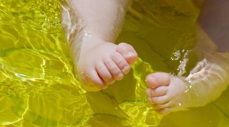 baby's feet: closeup babys feet in water