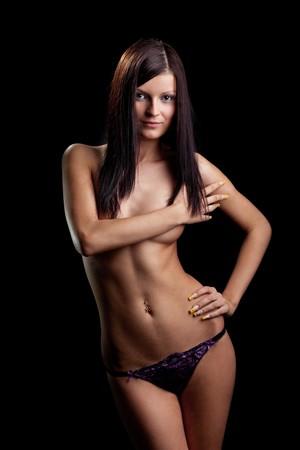 Perfect nude girl torso. On black background Stock Photo