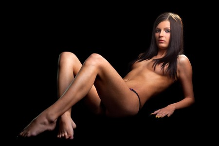 Perfect nude girl . On black background Stock Photo