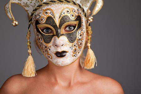 Portrait of beautiful young woman wearing carnival mask photo