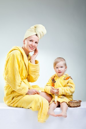 little daughter with her young mother  making up photo