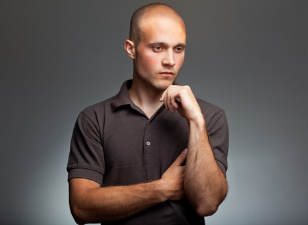 preoccupied: pensive young man in shirt Stock Photo