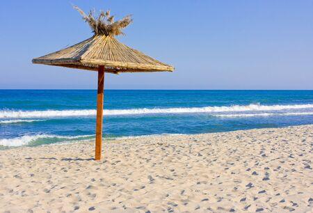 beach at summer with umbrella photo
