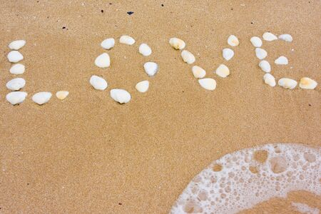 Love in sand on a beach photo