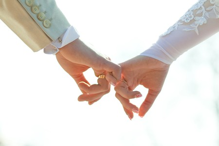 lovebirds: Close-up Holding Hands with Wedding Ring