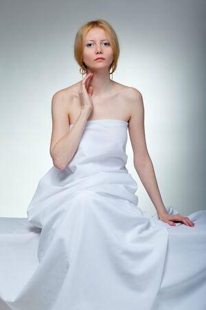 Beautiful young woman in towel sitting Stock Photo - 7187087
