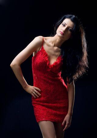 ladies bust: lovely girl in red dress over black