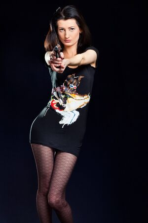 Sexy young Woman Holding Gun photo