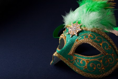green and gold mask on dark  background photo
