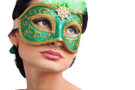 Portrait of beautiful woman wearing green carnival mask photo